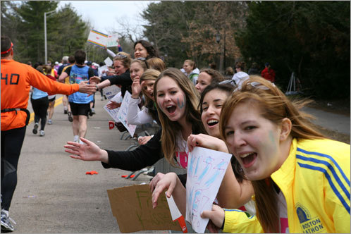 Students cheer for runners as they pass by Wellesley.
