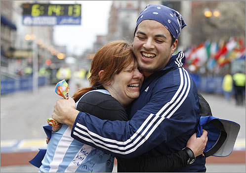 Lisa Burdick of Newton hugged her friend Harry Reyes. Reyes helped her run the final 6 miles at the finish line. Burdick was able to run 40 minutes faster than her last Boston Marathon.
