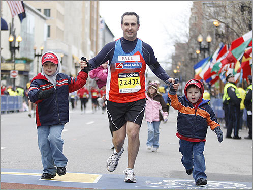 Paul Stone crossed the finish line with his sons Michael and Patrick.