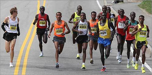 Shortly after passing milemarker 3, US runner Ryan Hall, far left, looked over at the front-running pack. Merga is the third from left with three-time defending champion Robert Kipkoech Cheruiyot is out in front.