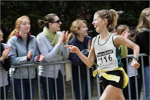 An elite women's runner appreciates the crowd at Wellesley College.