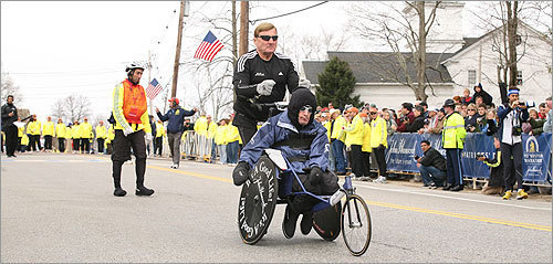 Dick Hoyt said he sees himself running the Boston Marathon while pushing his son, Rick, until he's at least 70 years of age.