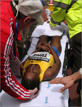 Tune receives medical attention and is lifted onto a stretcher at the finish line.