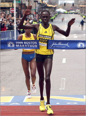 Kosgei crosses the finish line barely a second before Tune, the defending women's champion.