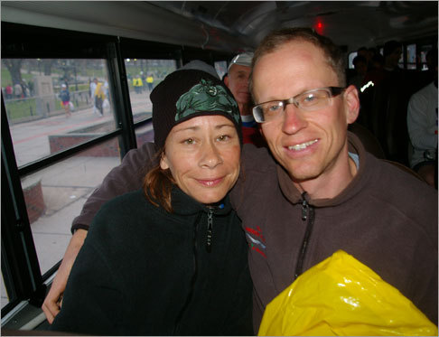 Nichol Des Jardins (left) and Eric Forte traveled from Santa Barbara, Calif., to run in the marathon. They loaded bus No. 4 early to get to Hopkinton as soon as possible.