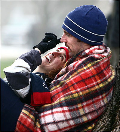 Stephanie Stewart and her boyfriend Nate Gilfoy, both of New Haven, Conn., cuddled for warmth near the starting line in Hopkinton. This is her second Boston Marathon and seventh overall. This is his first marathon. He's running for his father, who recently died of melanoma.