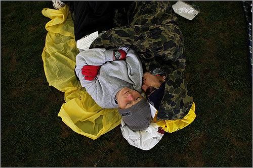 Alison Peters, left, and Brian Miller, both of Fort Worth, Texas, got some shut-eye before the start of the Boston Marathon in the Athlete's Village in Hopkinton.