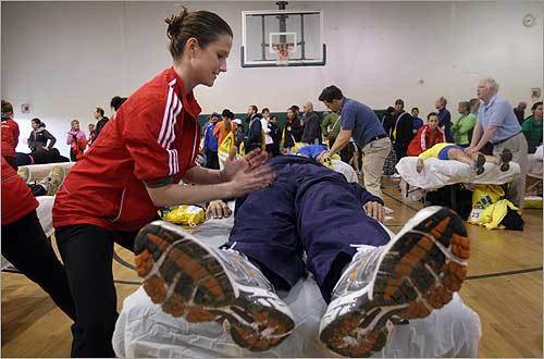Thousands of runners prepared to kick off the 113th Boston Marathon in Hopkinton this morning. Michelle Matthews gave runner Danny Wong of California a massage at Hopkinton Middle School.