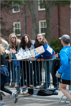 A first-year student offers kisses to runners.