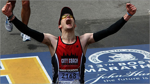 Gary Berard of New York lets out a yell after crossing the finish line.