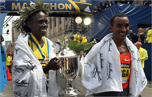 Female winner Salina Kosgei of Kenya with the winner of the men's race, Deriba Merga.
