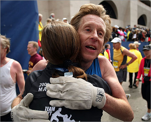 After crossing the finish line, Bill Rodgers was hugged by former Boston Marathon winner Uta Pippig.