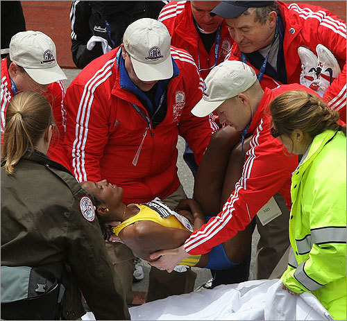 The second-place women's finisher, Dire Tune, collapsed at the finish and was helped to a stretcher.