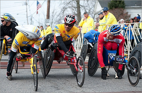 The wheelchair competitors prepared for the start of their race, which began before the elite runners' start.