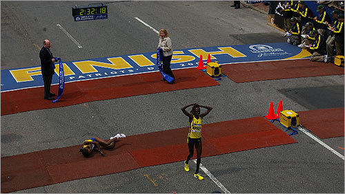 Salina Kosgei, 32, of El Marakwet, Kenya, won the women's crown edging defending champion Dire Tune, 23, of Addis Ababa, Ethiopia by less than two seconds. Tune feel to the ground at the finish line, being tended to by medical staff. Kara Goucher, 30, of Portland, Ore., finished third, several seconds after Tune. Kosgei finished in 2:32:16.
