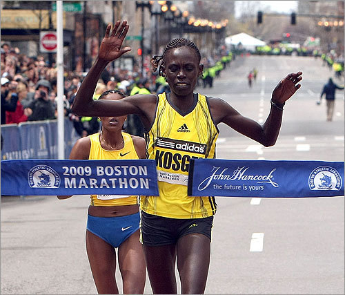 Salina Kosgei crossed the finish line just ahead of Dire Tune (rear).