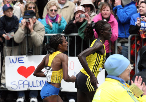 Salina Kosgei (right) was barely ahead of Dire Tune as the pair crossed Exeter street.