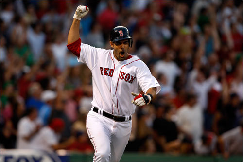 Red Sox third baseman Mike Lowell thrusts his fist in the air after hitting a three-run homer in the seventh inning, which put the Red Sox ahead 12-10.