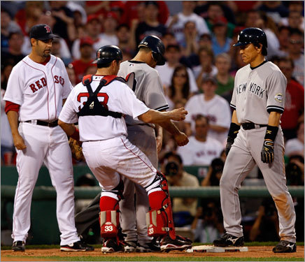 Red Sox catcher Jason Varitek tagged out Yankees catcher Jorge Posada, who was caught in a run down in the eighth inning.
