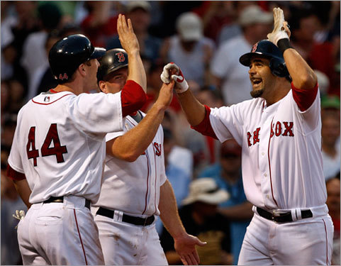 Lowell celebrated his homer with Jason Bay and Kevin Youkilis, both of whom scored on the three-run shot.