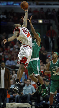 Tyrus Thomas (left) leapt over Boston's Rajon Rondo to try and haul in a long bomb pass at the buzzer that ended the first half.