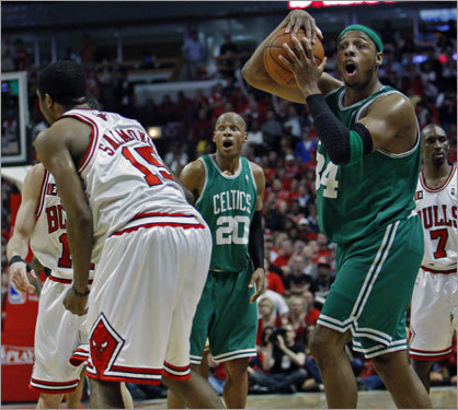 With the Bulls holding a 117-115 lead with 26 seconds left in the second overtime, Chicago inbounded the ball and Paul Pierce (right) got a hand on it momentarily at the same time the Bulls' John Salmons (left) did. Pierce was looking for either a Boston possession or a jump ball, but when the referee called the foul on the Boston captain, both he and teammate Ray Allen (background center) wore incredulous looks.