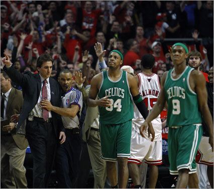 Paul Pierce and Rajon Rondo (right) walked away from Chicago with the series tied 2-2. Game 5 is Tuesday night in Boston.