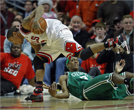 Derrick Rose controlled the ball over a fallen Celtics point guard Rajon Rondo in the first overtime.