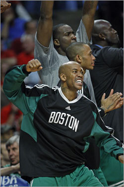 The Celtics bench, including Stephon Marbury, (front) Gabe Pruitt, Kendrick Perkins, and Kevin Garnett went wild when Brian Scalabrine (not pictured) hit a three pointer to open the scoring in the first overtime period that put Boston ahead 99-96.
