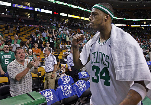 Paul Pierce pumps his fist as he leaves the floor following Boston's overtime victory over the Bulls.