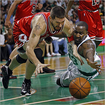 The Bulls' Brad Miller (left) and Kendrick Perkins (right) battled for a loose ball in the first half. Perkins lunged out at the ball and tapped it to teammate Glen Davis.