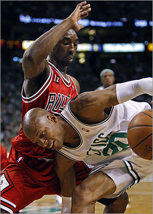 Ray Allen (right) takes the low road on a first half drive against Ben Gordon.