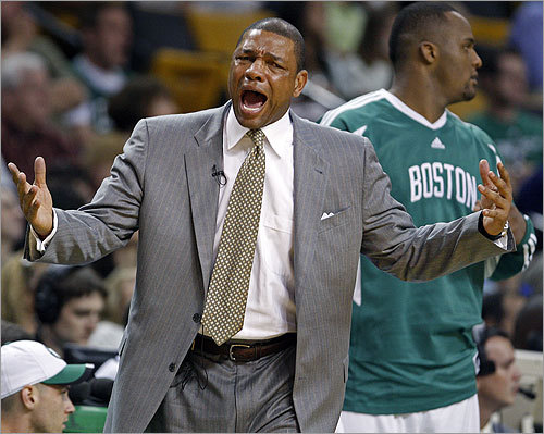 Head coach Doc Rivers (left, next to Glen 'Big Baby' Davis) howls after a first -half foul was called on Brian Scalabrine.