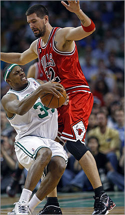 Paul Pierce (34) drives into Brad Miller during second-half action, drawing the foul.