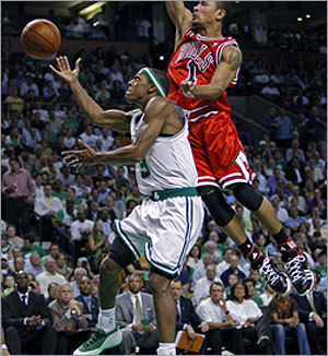 Rajon Rondo (left) drives to the hoop during first-half action while Derrick Rose tried to close in from behind.
