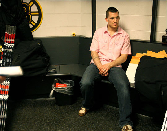 Ference sits in the Bruins' locker room as the team packs up after last season.