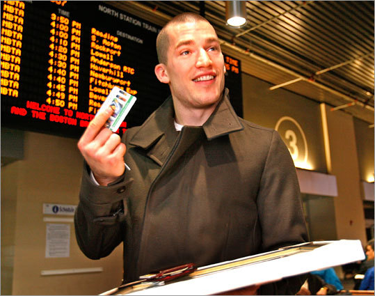 Ference holds up the MBTA's Charlie Card after receiving a commendation for his support of public transportation during a ceremony at North Station in November, 2007.