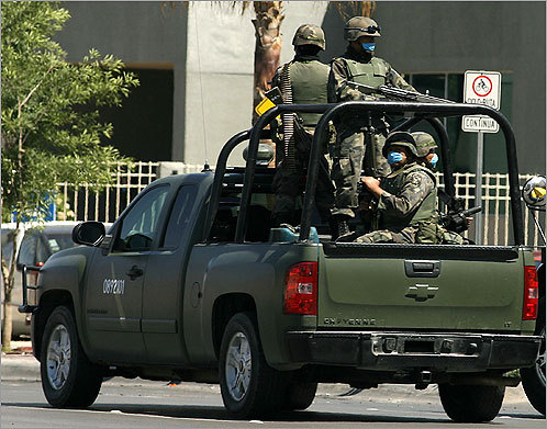 Mexican soldiers wearing surgical masks patrolled the streets of Juarez.