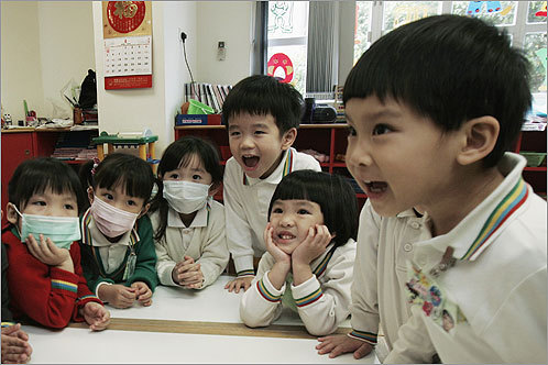 Some Hong Kong kindergarten students wore surgical masks during their lessons.