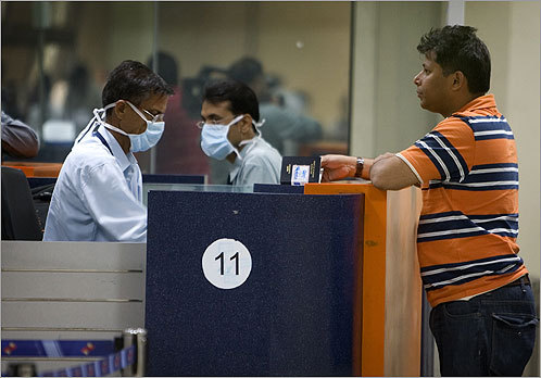 Swine flu has infected hundreds of people across the globe. It is estimated to have killed more than 150 people in Mexico. The possibility of a swine flu pandemic has inspired people across the world to take precautions to avoid contracting the virus. On April 30, Indian immigration officers wore surgical masks at the Indira Gandhi international airport in New Delhi to protect themselves.