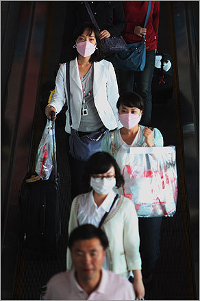 Passengers arriving at Beijing Capital International Airport wore surgical masks. The Chinese government is taking preventative measures against the spread of the H1N1 virus, or swine flu.