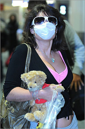 At Gatwick Airport in southern England, passengers arriving from a flight out of Cancun, Mexico, wore surgical masks.