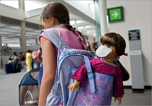 A girl in the International Airport of Mexico City protected her doll from the virus by putting a mask on it.