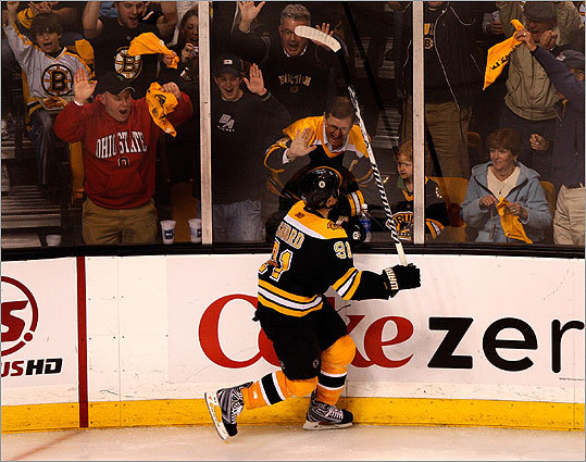 Savard celebrated with some Bruins fans after the goal.