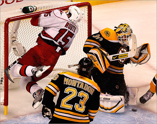 Hurricanes right wing Tuomo Ruutu crashed into the net, hitting the crossbar with his face, as Bruins goalie Tim Thomas made a save in the 1st period.