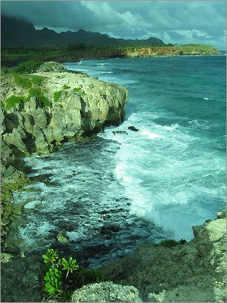 A storm begins to clear along the south coast of Kauai, Hawaii.