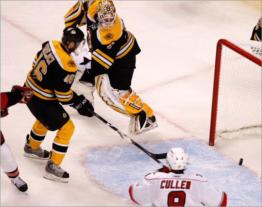 Boston's David Krejci (46) rushes to clear the puck as it teeters on the goal line late in the second period.