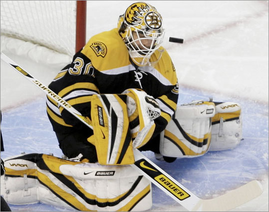 Bruins netminder Tim Thomas makes a first-period save against the Hurricanes during Game 2 of the Eastern Conference semifinals. Check out our gallery of shots from the game.