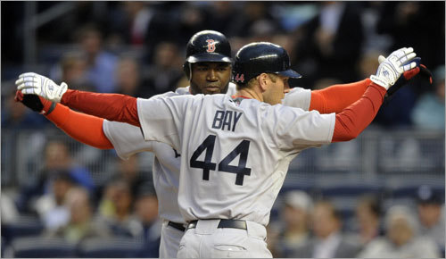 Bay was greeted by David Ortiz at home plate after Bay's three-run homer in the first inning.