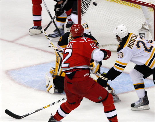 Boston's Steve Montador (23) can't stop Carolina Eric Staal (12) as the Hurricanes center turns a turnover into the game-tying goal in the second period.